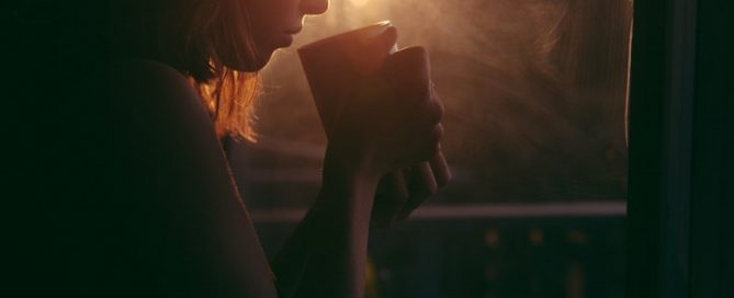 girl drinking coffee to warm up