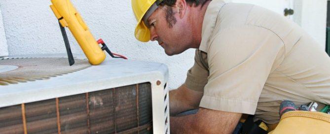 HVAC technician fixing AC unit