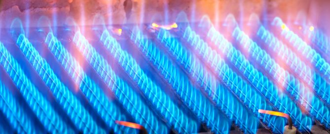 burners flaming from a gas furnace
