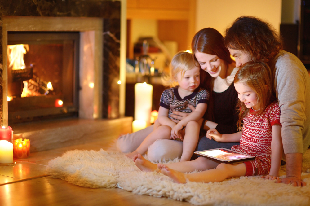 family plays in warm house