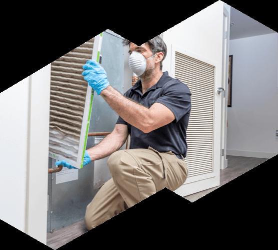 An Advanced HVAC technician changing an air filter