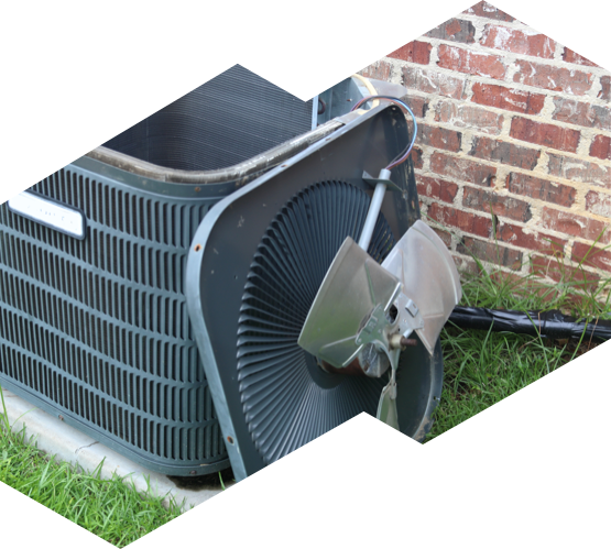 An air conditioning unit undergoing maintenance by Advanced HVAC