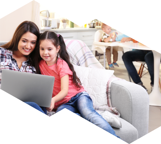 A mother and daughter on a lap top in their air conditioned Ottawa home