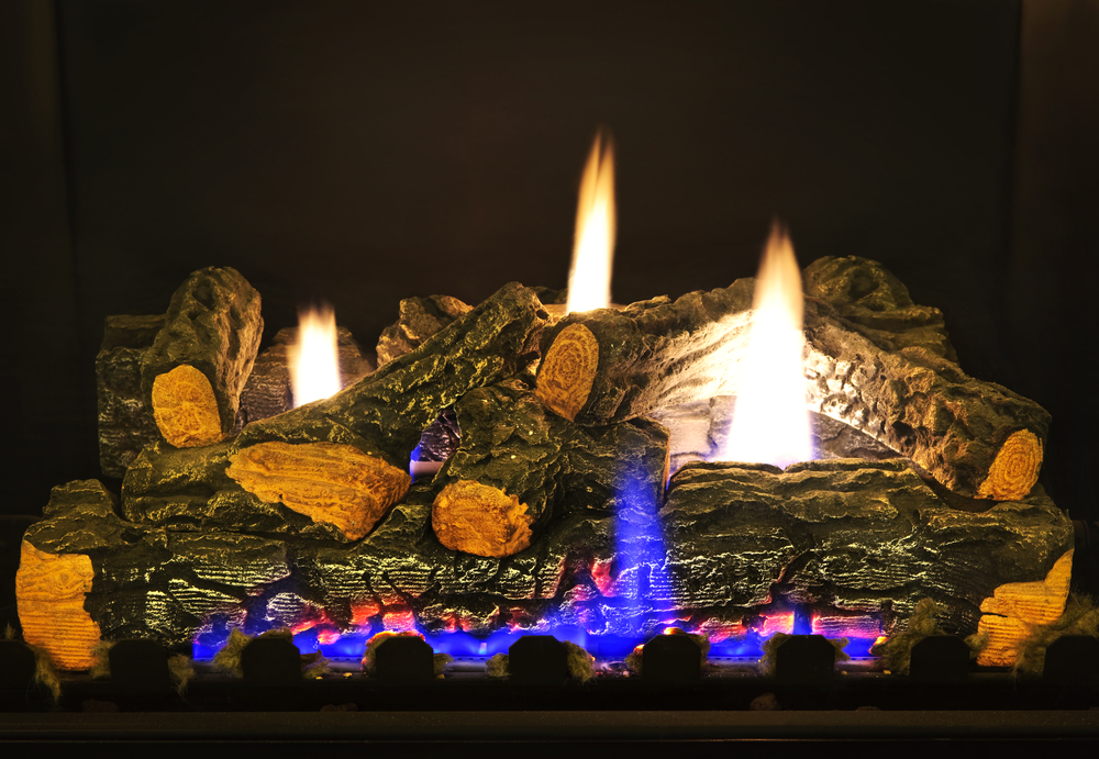 flames leap in gas fireplace