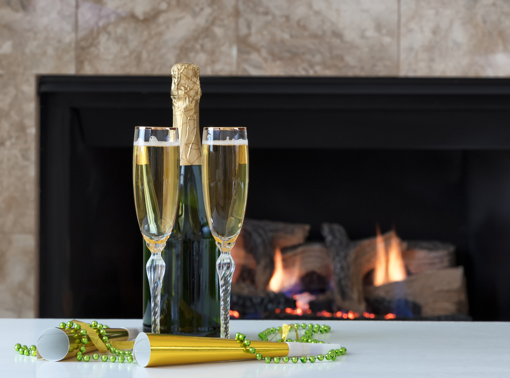 gas fireplace with champagne bottle and glasses