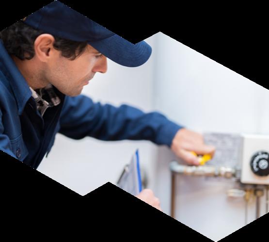 An advanced HVAC technician inspecting a hot water tank