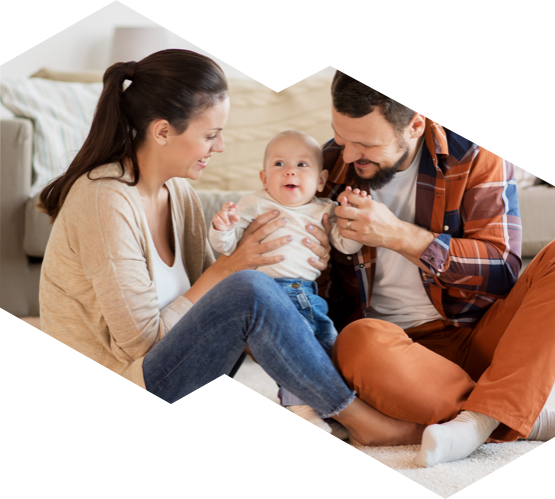 Young parents playing with their baby in an AC cooled home