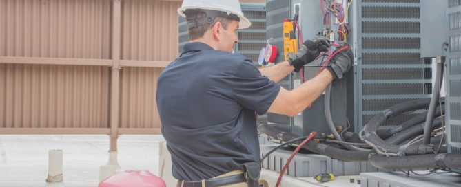 technician installing a commercial HVAC system