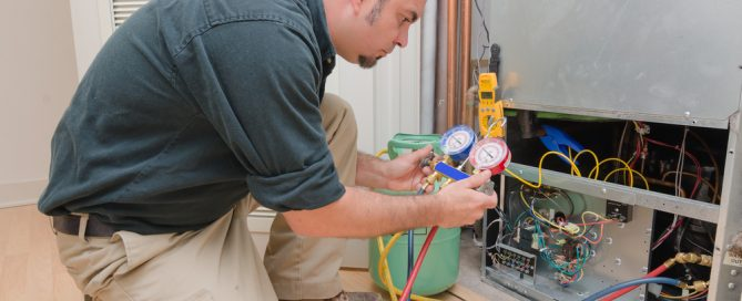 HVAC technician working on a heat pump to check the refrigerant level